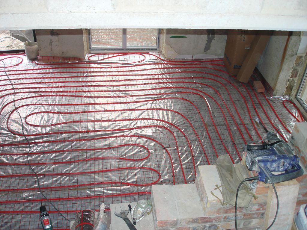 Монтаж теплого пода в холле